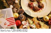 Купить «Close-up of various christmas desserts and gifts», видеоролик № 29690032, снято 31 августа 2016 г. (c) Wavebreak Media / Фотобанк Лори