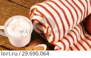 Купить «Rolled blanket with two apples and coffee mug», видеоролик № 29690064, снято 31 августа 2016 г. (c) Wavebreak Media / Фотобанк Лори