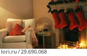 Купить «Fireplace decorate with christmas decor and ornaments», видеоролик № 29690068, снято 31 августа 2016 г. (c) Wavebreak Media / Фотобанк Лори