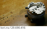 Купить «Close-up of clock repairing tool and screws», видеоролик № 29690416, снято 17 сентября 2016 г. (c) Wavebreak Media / Фотобанк Лори