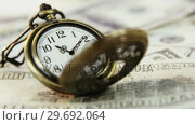 Купить «Close-up of pocket clock on euro dollar», видеоролик № 29692064, снято 12 августа 2016 г. (c) Wavebreak Media / Фотобанк Лори