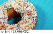 Купить «Close-up of tasty doughnuts with sprinkles», видеоролик № 29692092, снято 12 августа 2016 г. (c) Wavebreak Media / Фотобанк Лори