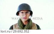 Купить «Portrait of solider in military uniform», видеоролик № 29692352, снято 23 августа 2016 г. (c) Wavebreak Media / Фотобанк Лори