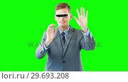 Купить «Businessman using virtual reality glasses», видеоролик № 29693208, снято 23 августа 2016 г. (c) Wavebreak Media / Фотобанк Лори