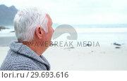 Купить «Portrait of senior man standing on beach», видеоролик № 29693616, снято 29 сентября 2016 г. (c) Wavebreak Media / Фотобанк Лори