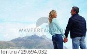 Купить «Mature couple holding hands and interacting», видеоролик № 29694032, снято 29 сентября 2016 г. (c) Wavebreak Media / Фотобанк Лори