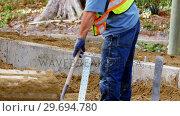 Купить «Worker working at construction site», видеоролик № 29694780, снято 5 октября 2016 г. (c) Wavebreak Media / Фотобанк Лори