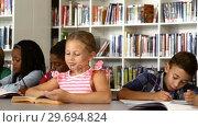 Купить «School kids studying in library», видеоролик № 29694824, снято 6 марта 2016 г. (c) Wavebreak Media / Фотобанк Лори