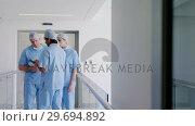 Купить «Team of surgeons discussing over medical reports», видеоролик № 29694892, снято 10 сентября 2016 г. (c) Wavebreak Media / Фотобанк Лори
