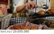 Купить «Female staff arranging baked croissant in basket at bakery section», видеоролик № 29695080, снято 4 октября 2016 г. (c) Wavebreak Media / Фотобанк Лори