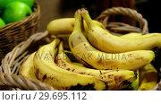 Купить «Close-up of bananas in basket», видеоролик № 29695112, снято 4 октября 2016 г. (c) Wavebreak Media / Фотобанк Лори