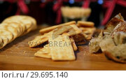 Купить «Various crispy biscuits and bread on counter», видеоролик № 29695140, снято 4 октября 2016 г. (c) Wavebreak Media / Фотобанк Лори