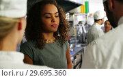 Купить «Chefs interacting with restaurant manager», видеоролик № 29695360, снято 21 ноября 2016 г. (c) Wavebreak Media / Фотобанк Лори