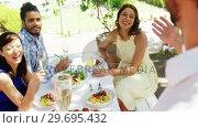 Купить «Group of friends toasting champagne glasses while having lunch», видеоролик № 29695432, снято 21 ноября 2016 г. (c) Wavebreak Media / Фотобанк Лори