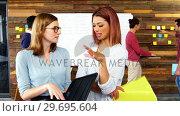 Купить «Business executives discussing over file in meeting», видеоролик № 29695604, снято 15 октября 2016 г. (c) Wavebreak Media / Фотобанк Лори