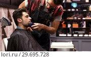 Купить «Man getting his beard trimmed with trimmer», видеоролик № 29695728, снято 19 сентября 2016 г. (c) Wavebreak Media / Фотобанк Лори