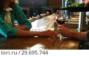 Купить «Barman serving red wine to female customer at bar counter», видеоролик № 29695744, снято 14 ноября 2016 г. (c) Wavebreak Media / Фотобанк Лори