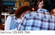 Купить «Couple interacting with each other at bar counter», видеоролик № 29695764, снято 14 ноября 2016 г. (c) Wavebreak Media / Фотобанк Лори