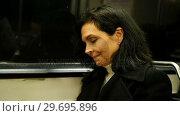 Купить «Woman travelling in train», видеоролик № 29695896, снято 12 июля 2020 г. (c) Wavebreak Media / Фотобанк Лори