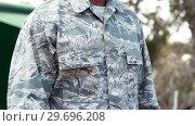 Купить «Military man standing in boot camp», видеоролик № 29696208, снято 24 ноября 2016 г. (c) Wavebreak Media / Фотобанк Лори