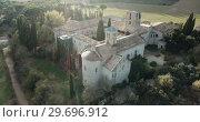 Купить «View from drone of ancient Romanesque monastery Sant Benet de Bagess, Catalonia, Spain», видеоролик № 29696912, снято 24 декабря 2018 г. (c) Яков Филимонов / Фотобанк Лори