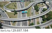 Купить «Aerial view of highway grade separation in Barcelona, Spain», видеоролик № 29697184, снято 12 июня 2018 г. (c) Яков Филимонов / Фотобанк Лори