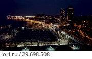 Купить «Barcelona seashore on Mediterranean in night lights, aerial view - blurred image», видеоролик № 29698508, снято 28 сентября 2018 г. (c) Яков Филимонов / Фотобанк Лори