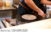 Купить «Chef pouring liquid dough onto the hot pan while preparing crepe», видеоролик № 29699020, снято 17 января 2017 г. (c) Wavebreak Media / Фотобанк Лори