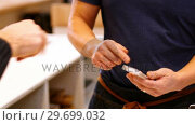 Купить «Customer making payment through credit card in counter», видеоролик № 29699032, снято 17 января 2017 г. (c) Wavebreak Media / Фотобанк Лори