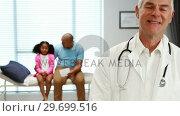 Купить «Portrait of smiling male doctor», видеоролик № 29699516, снято 5 ноября 2016 г. (c) Wavebreak Media / Фотобанк Лори