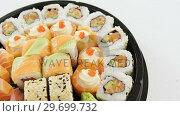 Купить «Tray of assorted sushi», видеоролик № 29699732, снято 8 декабря 2016 г. (c) Wavebreak Media / Фотобанк Лори