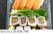 Купить «Sushi rolls with salmon », видеоролик № 29699748, снято 8 декабря 2016 г. (c) Wavebreak Media / Фотобанк Лори