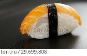 Купить «Nigiri sushi wrapped in nori seaweed», видеоролик № 29699808, снято 8 декабря 2016 г. (c) Wavebreak Media / Фотобанк Лори