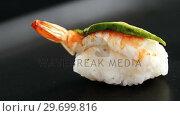 Купить «Sushi with shrimp served on gray stone slate», видеоролик № 29699816, снято 8 декабря 2016 г. (c) Wavebreak Media / Фотобанк Лори