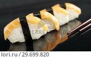 Купить «Nigiri sushi wrapped in nori seaweed», видеоролик № 29699820, снято 8 декабря 2016 г. (c) Wavebreak Media / Фотобанк Лори