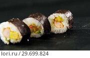 Купить «Maki sushi on black background», видеоролик № 29699824, снято 8 декабря 2016 г. (c) Wavebreak Media / Фотобанк Лори