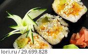 Купить «Maki sushi roll served on tray», видеоролик № 29699828, снято 8 декабря 2016 г. (c) Wavebreak Media / Фотобанк Лори