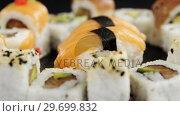 Купить «Various sushi on black background», видеоролик № 29699832, снято 8 декабря 2016 г. (c) Wavebreak Media / Фотобанк Лори