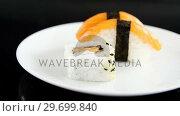 Купить «Sushi served on plate», видеоролик № 29699840, снято 8 декабря 2016 г. (c) Wavebreak Media / Фотобанк Лори