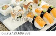 Купить «Set of assorted sushi served on tray», видеоролик № 29699888, снято 8 декабря 2016 г. (c) Wavebreak Media / Фотобанк Лори