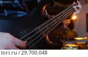 Купить «Band performing in studio», видеоролик № 29700048, снято 23 ноября 2016 г. (c) Wavebreak Media / Фотобанк Лори