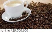 Купить «Cup of coffee with roasted beans», видеоролик № 29700600, снято 6 октября 2016 г. (c) Wavebreak Media / Фотобанк Лори