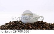 Купить «Cup of black coffee with roasted coffee beans», видеоролик № 29700656, снято 6 октября 2016 г. (c) Wavebreak Media / Фотобанк Лори