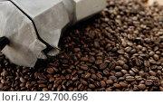 Купить «Coffee beans with metallic coffeemaker», видеоролик № 29700696, снято 6 октября 2016 г. (c) Wavebreak Media / Фотобанк Лори
