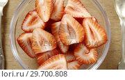 Купить «Close-up of strawberries slices in bowl», видеоролик № 29700808, снято 19 декабря 2016 г. (c) Wavebreak Media / Фотобанк Лори