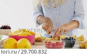 Купить «Woman cutting pineapple on chopping board», видеоролик № 29700832, снято 19 декабря 2016 г. (c) Wavebreak Media / Фотобанк Лори