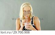Купить «Beautiful woman drinking smoothie», видеоролик № 29700908, снято 19 декабря 2016 г. (c) Wavebreak Media / Фотобанк Лори