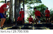 Купить «Trainer training kids in the boot camp», видеоролик № 29700936, снято 16 марта 2017 г. (c) Wavebreak Media / Фотобанк Лори
