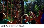 Купить «Female trainer giving high five to women during obstacle course», видеоролик № 29701072, снято 16 марта 2017 г. (c) Wavebreak Media / Фотобанк Лори