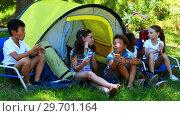 Купить «Kids having marshmallows outside tent», видеоролик № 29701164, снято 2 марта 2017 г. (c) Wavebreak Media / Фотобанк Лори